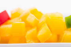 Diced Red, Green & Yellow Pepper. Diced Red, Green & Yellow Pepper together in white plate close up Stock Photos