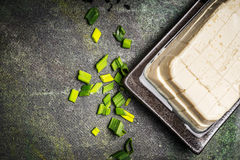 Diced Silken tofu on rustic background, top view Stock Photo