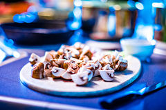 Diced and sliced mushrooms on table Stock Photos