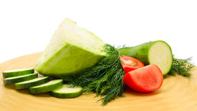 Diced vegetables. Sliced ​​cabbage, tomato and zucchini on the kitchen blackboard stock image