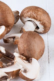 Diced and whole agaricus brown button mushrooms Stock Photos