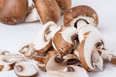 Diced and whole agaricus brown button mushrooms Royalty Free Stock Image