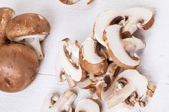 Diced and whole agaricus brown button mushrooms Stock Photo