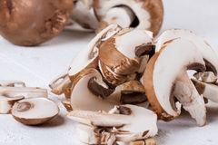Diced and whole agaricus brown button mushrooms Stock Image