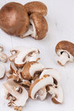 Diced and whole agaricus brown button mushrooms Royalty Free Stock Images
