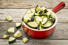 Diced zucchini in stoneware pot Royalty Free Stock Images