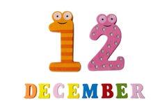 12 dicembre su fondo, sui numeri e sulle lettere bianchi Fotografia Stock Libera da Diritti
