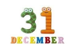 31 dicembre su fondo, sui numeri e sulle lettere bianchi Fotografie Stock