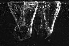 Dices в воде Стоковая Фотография