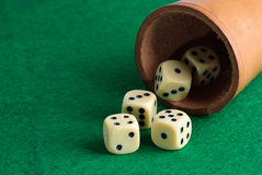 Dices. On a green background Stock Photo