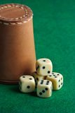 Dices. On a green background Royalty Free Stock Images