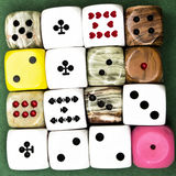 Dices. 16 dices on green background Stock Images