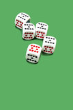 Dices. Five Dices on green background Royalty Free Stock Image