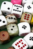 Dices. Many  different dices on green background Stock Photo