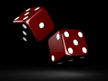 Dices. Red dices with white dots on dark background Royalty Free Stock Image