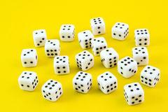 Dices. Small dices isolated on yellow background Royalty Free Stock Photo