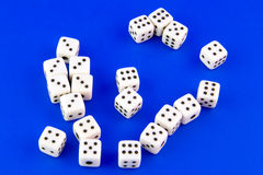 Dices. Small dices isolated on blue background Stock Photos