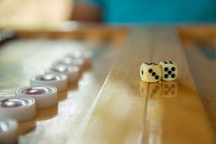 Dices for backgammon. Back gammon table game close up shot. Dices for backgammon. Back gammon table game close up shot with selective focus stock photography