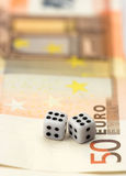 Dices and bills Stock Photos