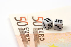 Dices and bills Royalty Free Stock Photo