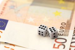 Dices and bills Stock Photography