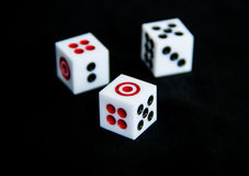 3 dices on black background. 3 dices with variety of number on black background Royalty Free Stock Photography