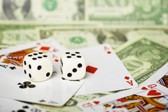 Dices are on cards and money Royalty Free Stock Images