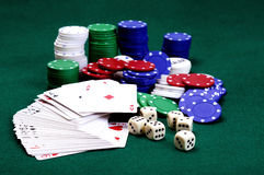 Dices , cards and  Poker chips. Dices , cards and stack of Poker chips and dealer button on a green background Stock Image
