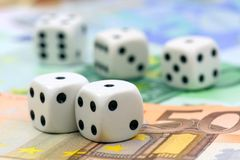 Dices on cash. Dices on euro money background Stock Photos