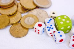 Dices and coins Stock Images