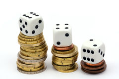 Dices and coins Stock Photos