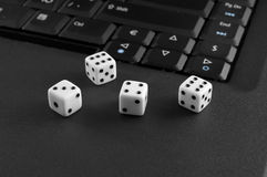Dices with computer Royalty Free Stock Image