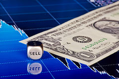 Dices cube with the word SELL, one-dollar banknote Royalty Free Stock Photo