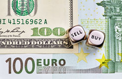 Dices cubes, USD,EUR  banknotes. Dices cubes with the words SELL BUY, USD,EUR  banknotes Stock Photo