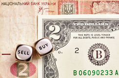 Dices cubes, USD, UAH banknotes Royalty Free Stock Image