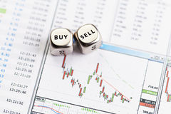 Dices cubes with the words SELL BUY on downtrend  diagram Royalty Free Stock Images