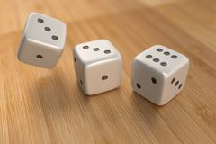 Three dice on wood floor Royalty Free Stock Image