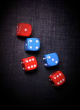 Dices. 5 dices on a dark background Royalty Free Stock Image