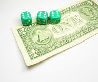Dices on dollar Royalty Free Stock Photos