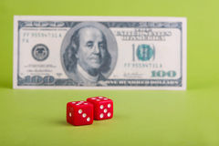 Dices with dollar. Two  dices in front of dollar  banknote Stock Photography