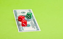 Dices with dollar. Three  dices on dollar  banknote on the paper Royalty Free Stock Images