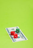 Dices with dollar. Three  dices on dollar  banknote on the paper Royalty Free Stock Photo
