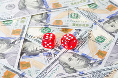 Dices and dollars Royalty Free Stock Photos