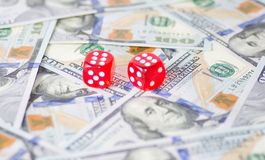 Dices and dollars Stock Photos