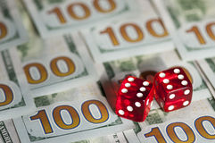 Dices and dollars Stock Image