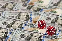 Dices and dollars Stock Photography