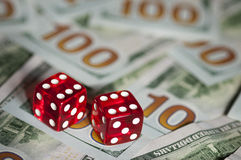 Dices and dollars Royalty Free Stock Image