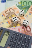 Dices and euro money. White dices and calculator over euro money Stock Image