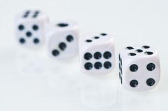 Dices falling down against white background. Royalty Free Stock Images