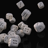Dices falling. White game dices falling and black background Stock Images